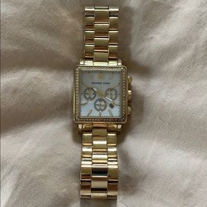 Michael Kora gold color watch